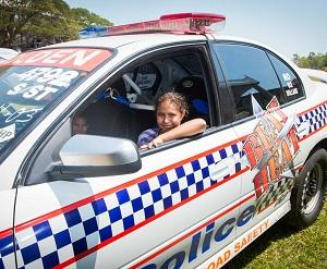 """Amelia Kadiba checks out the """"Beat the Heat"""" road safety police racing car at last year's CDU Open Day"""
