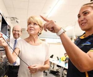 Second year electrical apprentice Nadine Braun, from Darwin, shows Foreign Minister Ms Julie Bishop and Vice-Chancellor Professor Simon Maddocks the workings of a motor simulator.