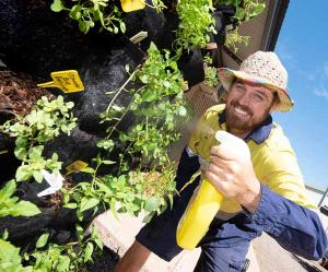 Horticulture student Ben Nicholls with the vertical edible garden