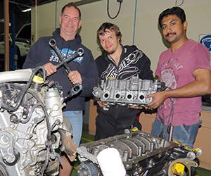 Automotive lecturer Rob Tucker with flying spanners competitors Alex Riley and Eldhose Thomas