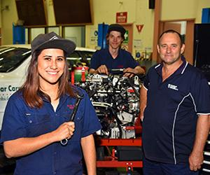 (From left): Chanel Lambert and colleague Curtis Smith take some tips from CDU Automotive Technology lecturer Bruce Kimm.