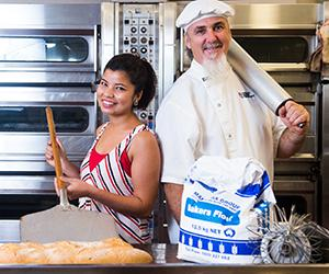 Palmerston campus will host NT Food Week in October. Pictured: Dibya Bajracharya and VET lecturer Bill Denniss
