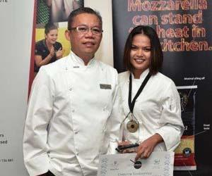 NT Australian Culinary Federation representative John Borlagdan and Champion First Year Apprentice Maria Hoad
