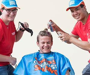 CDU Student Ambassadors April Payne and Patrick Chin prepare for the World's Greatest Shave. Pictured with Augustine Thorbjornsen