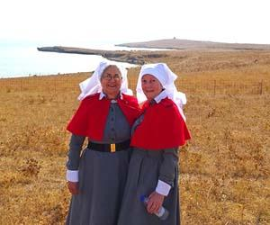 CDU Nursing Museum curator Janie Mason (left) and Julie Lloyd at the re-enactment last year of the arrival of the Anzac nurses at Lemnos Island