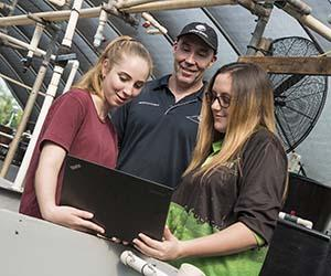 From left: Kayla Weckert, Chad Mumme and Taleeha Ramsay check out the Island Ranger app