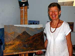 """Ms Taylor with one of the landscapes in the """"Portraits of Country"""" exhibition."""
