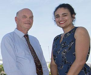 DVC Research and Research Training Professor Lawrence Cram celebrates with Minister for Environment and Natural Resources Ms Lauren Moss