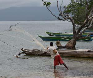 A fisher in Timor-Leste casts his net over small schools of inshore fish in front of his village. Photo: Dirk Steenbergen