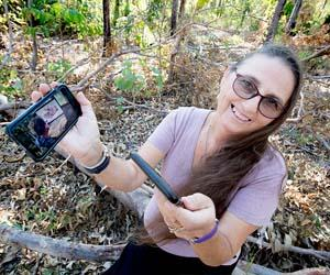 Research fellow Marianne St Clair shows how her smartphone can be used as a diagnostic tool