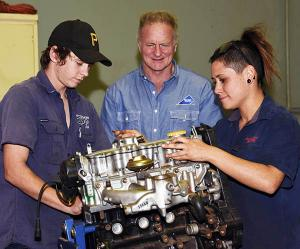 Automotive Lecturer Russ Horan (centre) with apprentices Luke McAskill and Chanel Lambert.