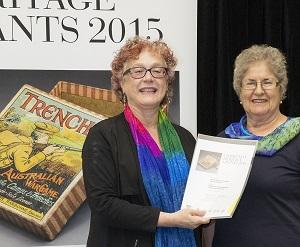 Federal Ministry for the Arts executive director Sally Basser (left) presents the Community Heritage Grant certificate to CDU Nursing Museum curator Janie Mason