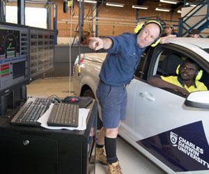 Automotive lecturer Mark James (left) and student Terrence Bismark check engine data from a ute on the new dynamometer, which will be on display at Open Day on Sunday, 20 August. Photo: Julianne Osborne