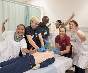 (From left) Darmi Messakh, Alix Burke, Farmo Siryon, Dev Lamichhane, Health lecturer Lisa Barton and Simone Byrne practice performing CPR to the beat of Bee Gees' hit Stayin' Alive ahead of Open Day on Sunday, 20 August.