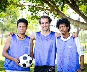 Jiwan Gajmer, Pat Sims and Bertanizo Guro are training together to participate in the Football Cup