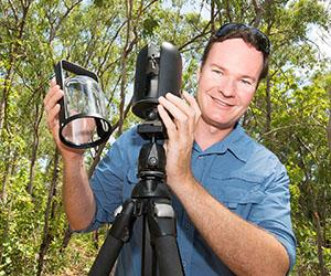 Dr Shaun Levick uses the 1kg Leica BLK360 laser scanner to map field sites that can only be accessed on foot. Photo: Julianne Osborne