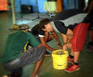 Floor exercise: Army reservists carry out repairs to the floor of Binjarri church near Katherine.