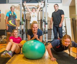 Back: Darwin swimming coach Clare Labowitch, swimmer Sam Bricknell and CDU lecturer in Exercise and Sports Science Dr Daniel Gahreman. Front: Swimmers Emily Williamson, Lauren McSkimming and Alice Milikins.