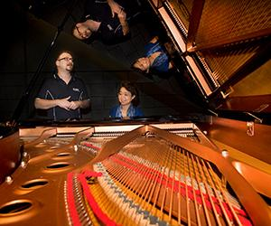 CDU piano lecturer Chen Hui – who will perform at the Stage Door Club – making music with Paolo Fabris.