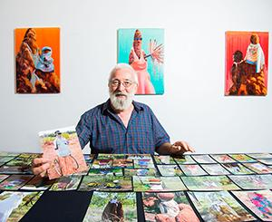 CDU Masters student Ian Hance is collecting stories and painting portraits of decorated termite mounds