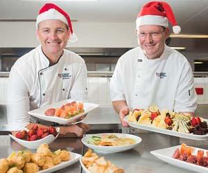 CDU cookery lecturer Matthew Cook and pastry lecturer David Barker say a Territory tapas style lunch is more on-trend and better suited for Territorians planning their Christmas Day feasts