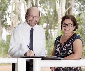Charles Darwin University Vice-Chancellor Professor Simon Maddocks and Desert Knowledge Australia Chief Executive Officer Lauren Ganley at the Memorandum of Understanding signing