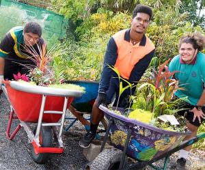 From left – Willis Taripo, Romone Lewin and Bradley Garlepp with their wheelbarrow gardens