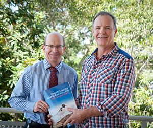 Co-editor Professor Stephen Garnett (right) says the hard work has paid off. Pictured with Vice-Chancellor Professor Simon Maddocks