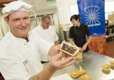 Bakery lecturer David Barker checks the quality of the pies