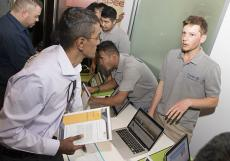 Samuel Walledge explains his Riverland Link System to an interested attendee