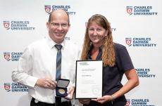 Trish Mellow receives an award for 10 years service