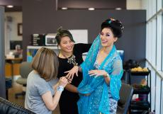 From left: students Susma Maski and Suzie Riamam prepare model Suzu Thapa for the runway