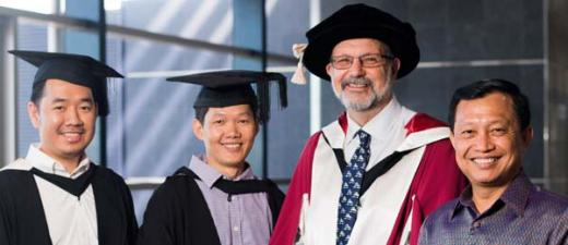 Masters by research graduates Novuthny Hak and Ly Tran with Professor Peter Kell and His Excellency Mr Ngoy Mak