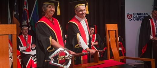 Outgoing Chancellor The Honourable Sally Thomas AC passes the power and authority of the position to the incoming Chancellor Mr Neil Balnaves AO