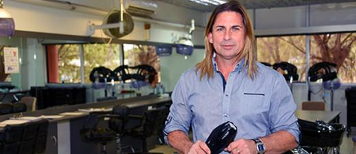 Hairdressing trainer Wayne Elphick in the Alice Springs campus salon