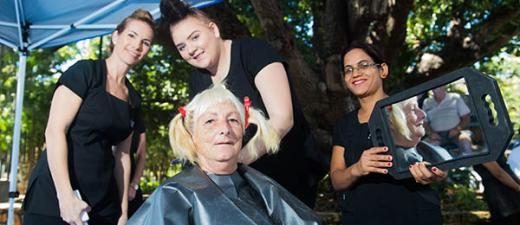Hairdressing trainer Jasmine Martin (left) and students Tiani O'Shaughnessy and Devaki Poudell put the finishing touches on a client