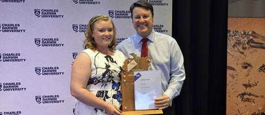 Welding and Metal Fabrication apprentice Kacie Anderson receives her award from Inpex Darwin's Sean Kildare. Image: Rohan Badenhop