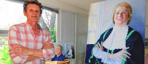 Visual arts lecturer Henry Smith with the portrait of the NT Speaker