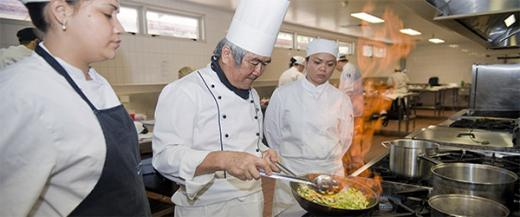 Cookery lecturer TY Lee with students in the commercial kitchen on Palmerston campus