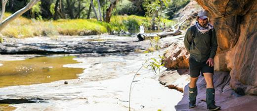 PhD candidate Simon Votto inspects a Central Australian riverbed. Image: Charles Davis