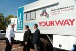 VC Professor Barney Glover with Senator Chris Evans in front of the Mobile Learning Unit (ACIKE) at the opening of International House Darwin  2012