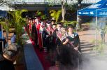 Ceremonial mace bearer, Chief Operating Officer Debra Farrelly leads the academic procession.