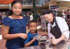 Rosebery Primary School students Sauyata Gurung and her brother Sampurnah Gurung make chocolate pasta with VET lecturer Tracey Poelsma