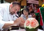 Commercial Cookery and Bakery team leader Robert Schwerdt shows Steven Griffith how to carve a watermelon
