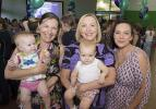 NT Administrator Vicki O'Halloran (centre) recognised mothers for their contribution to life in the NT, including Katrina Kawaljenko (left), with daughter Adalynn Smith, and Bex Garrett, with daughter Layla Kirby