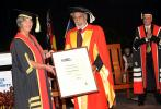 The Hon Sally Thomas AM presents Dr Kay Rala Xanana Gusmao an Honorary Doctorate at the CDU Darwin graduation ceremony in 2012.